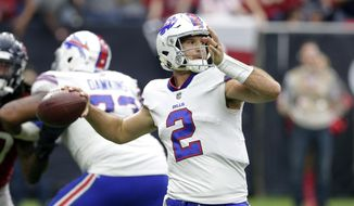 FILE - In this Oct. 14, 2018, file photo, Buffalo Bills quarterback Nathan Peterman (2) passes during the second half of an NFL football game against the Houston Texans, in Houston. With Derek Anderson's status uncertain due to a concussion, the Buffalo Bills are left with little choice in turning to interception-prone Nathan Peterman as their potential starter against the Chicago Bears this weekend. (AP Photo/Michael Wyke, File)