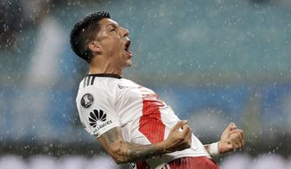 Enzo Perez of Argentina's River Plate celebrates after River defeated Brazil's Gremio during a semifinal second leg match of the Copa Libertadores in Porto Alegre, Brazil, Tuesday, Oct. 30, 2018. River advances to the final. (AP Photo/Andre Penner)