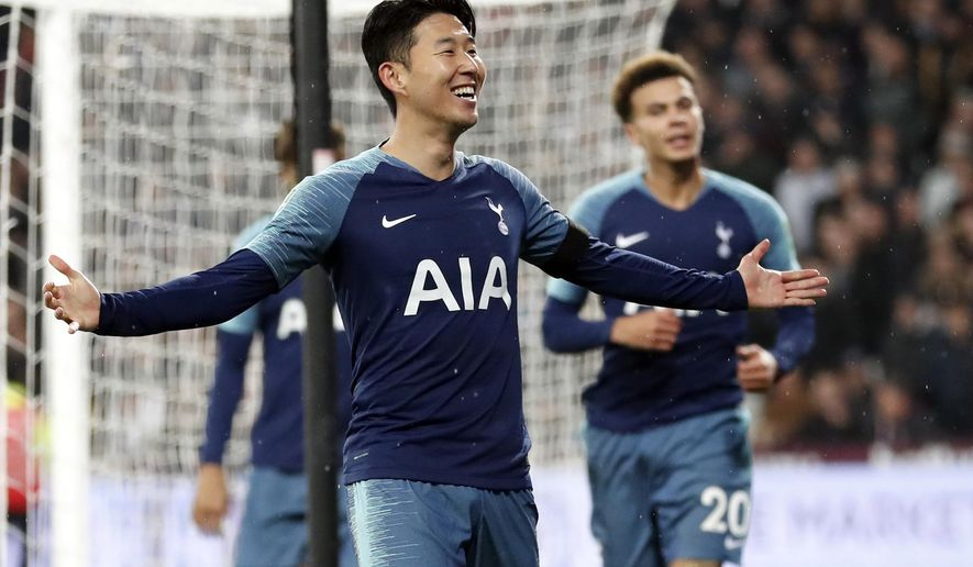 Tottenham Hotspur's Son Heung-Min celebrates after scoring his side's second goal during the English League Cup 4th round soccer match between West Ham United and Tottenham Hotspur at the London stadium in London, Wednesday, Oct. 31, 2018. (AP Photo/Alastair Grant)