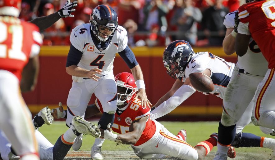 Kansas City Chiefs linebacker Dee Ford (55) sacks Denver Broncos quarterback Case Keenum (4), causing him to fumble the ball for a turnover, during the second half of an NFL football game in Kansas City, Mo., Sunday, Oct. 28, 2018. Linebacker Breeland Speaks (57) recovered the fumble. (AP Photo/Charlie Riedel)