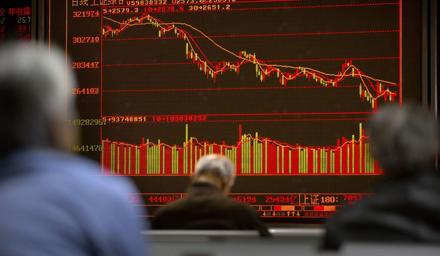 Chinese investors monitor stock prices at a brokerage house in Beijing, Wednesday, Oct. 31, 2018. Asian markets were mostly higher on Wednesday after big American companies reported strong earnings for the third quarter, soothing fears that rising interest rates may weigh on business appetite. (AP Photo/Mark Schiefelbein)