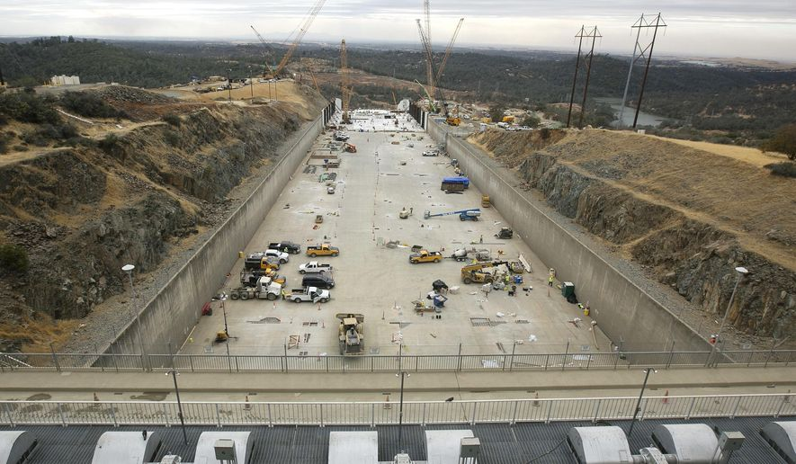 FILE -- In this Oct. 19, 2017 file photo crews work to repair the damaged main spillway of the Oroville Dam in Oroville, Calif. The Department of Water Resources announced Wednesday, Oct. 31, 2018 that it has met its Nov. 1 goal of completely reconstructing the dams main spillway in time for the upcoming winter. The main spillway and emergency spillway suffered significant damage during storms in February of 2017, prompting fears of massive flooding. (AP Photo/Rich Pedroncelli, file)