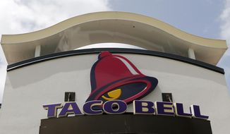 This Aug. 3, 2017, file photo shows a Taco Bell sign at a restaurant in Hialeah, Fla.  (AP Photo/Alan Diaz, File) **FILE**