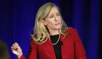 In this Oct. 15, 2018, file photo, Abigail Spanberger gestures during a debate with Virginia Congressman Dave Brat, R-Va., at Germanna Community College in Culpeper, Va. (AP Photo/Steve Helber, File)