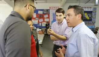 In this photo taken Thursday, Oct. 25, 2018, Josh Harder, second from right, the Democratic candidate for the California 10th Congressional District, talks with supporters, Ceres High students Matthew Ochoa, left, and Elizabeth Lopez, second from left, in Modesto, Calif. Harder was joined by California Congressional Rep. Pete Aguilar, Southern Californian Democrat, who came to campaign with Harder in his attempt to unseat incumbent Republican Rep. Jeff Denham in the November election. (AP Photo/Rich Pedroncelli)