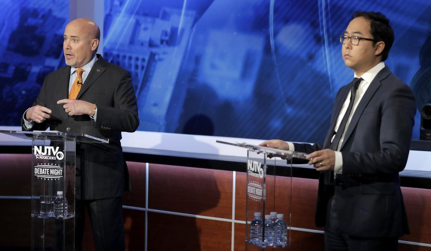 Tom MacArthur, left, Republican candidate in the U.S. Congressional District 3 race, speaks during a debate with Democratic candidate Andy Kim, Wednesday, Oct. 31, 2018, in Newark, N.J. (AP Photo/Julio Cortez)