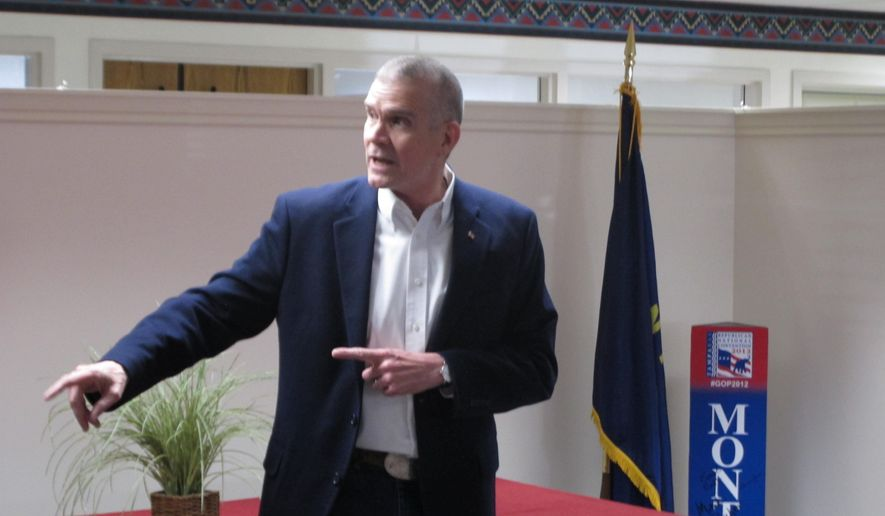 In this Oct. 23, 2018 photo Senate candidate Matt Rosendale of Montana makes a speech during a rally in Helena, Mont. Rosendale is in a tight race against incumbent Democratic Sen. Jon Tester.(AP Photo/Matt Volz)