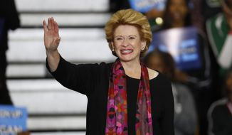 Sen. Debbie Stabenow, D-Mich., waves during a rally in Detroit Friday, Oct. 26, 2018. (AP Photo/Paul Sancya)