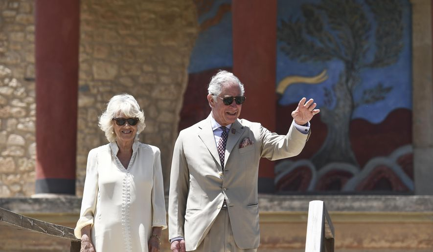 FILE - In this May 11, 2018, file photo, Britain's Prince Charles, and his wife Camilla, Duchess of Cornwall, visit the ancient site of Knossos on the southern Greek island of Crete. The royal couple have arrived in Gambia for a three-day visit. President Adama Barrow and first lady Fatoumata Barrow greeted the royal couple on Wednesday, Oct. 31, along with Gambians who came out in throngs for their arrival. (Aris Messinis/Pool Photo via AP, File)