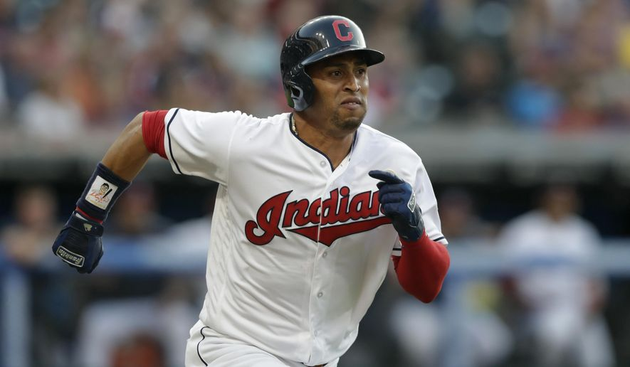 FILE - In this Aug. 4, 2018, file photo, Cleveland Indians' Leonys Martin runs out a ground ball during the team's baseball game against the Los Angeles Angels in Cleveland.  Martin and the Cleveland Indians have agreed to a 1-year, $3 million contract for next season. Martin survived a life-threatening illness last season after coming over in a trade from Detroit. He was arbitration eligible. The Indians expect Martin to be ready for the start of spring training following his medical ordeal, which was the result of him contracting a viral bacteria.  (AP Photo/Tony Dejak, File)