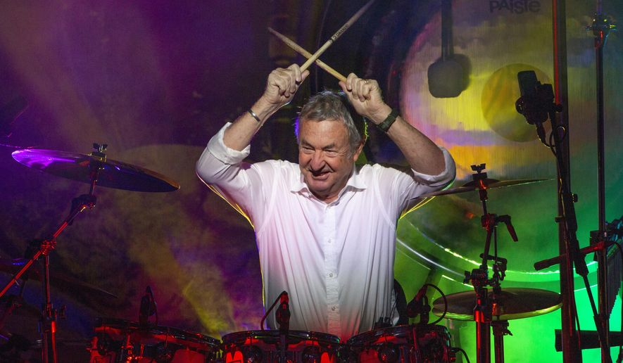 """This Sept. 23, 2018 photo released by Jill Furmanovsky shows Pink Floyd drummer Nick Mason performing with Nick Mason's Saucerful of Secrets band in Portsmouth, England.  Mason is planning to tour North America next year to perform some classic Floyd songs. His band will be jamming to pre-""""Dark Side of the Moon"""" material. (Jill Furmanovsky/www.rockarchive.com via AP)"""
