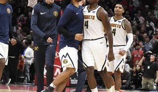 Denver Nuggets forward Paul Millsap (4) celebrates his go-ahead basket against the Chicago Bulls with his teammates during overtime of an NBA basketball game Wednesday, Oct. 31, 2018, in Chicago.The Nuggets won 108-107. (AP Photo/David Banks)