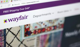 FILE- This April 17, 2018, file photo shows the Wayfair website on a computer in New York. Several sites have made it more affordable to get design help without anyone ever stepping inside your home. Havenly, Wayfair and others are charging less than $100 a room to connect users with an interior designer who can pick out a sofa, show you how to rearrange furniture or offer other design help. (AP Photo/Jenny Kane, File)