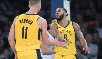 Indiana Pacers forward Domantas Sabonis (11) and guard Cory Joseph (6) celebrate during the second half of an NBA basketball game against the New York Knicks, Wednesday, Oct. 31, 2018, at Madison Square Garden in New York. The Pacers won 107-101. (AP Photo/Mary Altaffer)