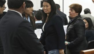 Keiko Fujimori, the daughter of Peru's former President Alberto Fujimori, and leader of the opposition party, center, attends a hearing where prosecutors are asking for 36 months of preventive detention for the alleged crime of money laundering, in Lima, Peru, Wednesday, Oct. 24, 2018. She remains under investigation over some $1.2 million in undeclared financial contributions to her 2011 presidential campaign that were allegedly made by Odebrecht, the Brazilian construction firm at the heart of Latin America's largest-ever graft scandal. (AP Photo/Martin Mejia)