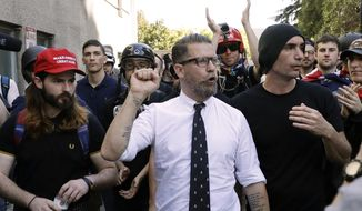 Gavin McInnes, center, founder of the far-right group Proud Boys, is surrounded by supporters after speaking at a rally in Berkeley, California, in this April 27, 2017, file photo. (AP Photo/Marcio Jose Sanchez)