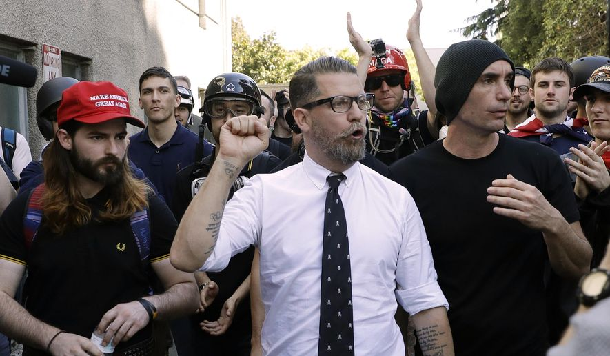 Gavin McInnes, center, founder of the far-right group Proud Boys, is surrounded by supporters after speaking at a rally in Berkeley, California, in this April 27, 2017, file photo. (AP Photo/Marcio Jose Sanchez) ** FILE **