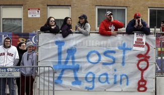 Boston Red Sox fans line the parade route, waiting to celebrate the team's World Series championship over the Los Angeles Dodgers, Wednesday, Oct. 31, 2018, in Boston. (AP Photo/Charles Krupa)