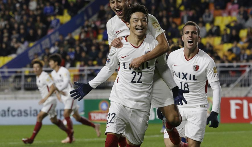 Japanese Kashima Antlers' Daigo Nishi celebrates with his teammate Yuma Suzuki after scoring a goal against South Korean Suwon Samsung Bluewings during the second-leg semifinal of the Asian Champions League at Suwon World Cup Stadium in Suwon, South Korea, Wednesday, Oct. 24, 2018. (AP Photo/Ahn Young-joon)