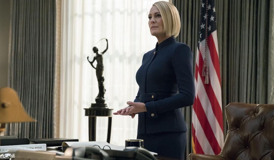"""This image released by Netflix shows Robin Wright in a scene from the final season of """"House Of Cards."""" (David Giesbrecht/Netflix via AP)"""