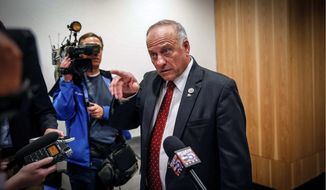 Congressman Steve King speaks to the media before his candidate forum at the Greater Des Moines Partnership office in Des Moines, Iowa, Thursday, Nov. 1, 2018. King is rejecting accusations that he's associated with an Austrian white supremacist group. Those claims have prompted condemnation from within his own party just days before Tuesday's election. (Bryon Houlgrave/The Des Moines Register via AP)