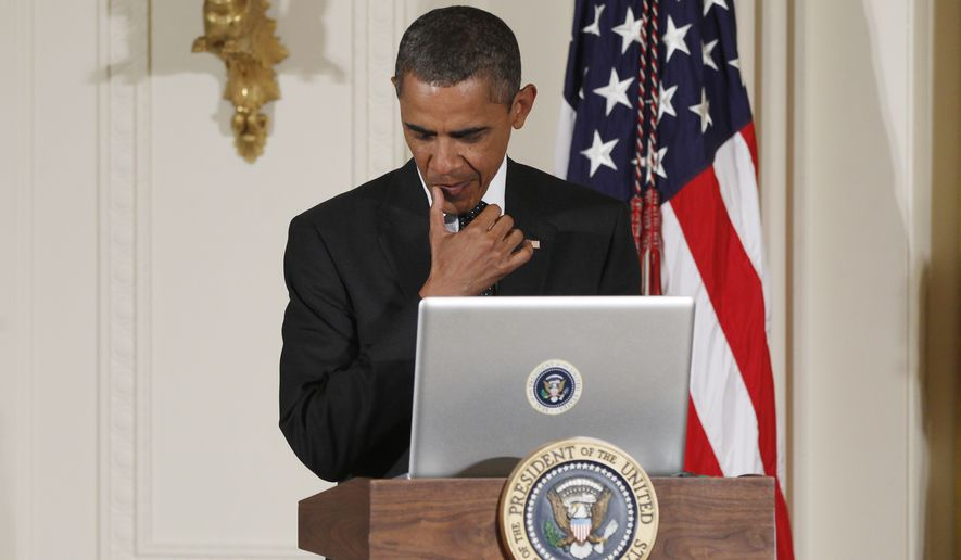 "President Barack Obama uses a laptop computer to send a tweet during a ""Twitter Town Hall"" in the East Room of the White House in Washington, Wednesday, July 6, 2011. (AP Photo/Charles Dharapak) **FILE**"