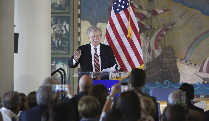 The Assistant to the President for National Security Affairs, Ambassador John Bolton, delivered remarks at the National Historic Landmark Miami Freedom Tower Nov. 1, 2018. Bolton spoke about the Trump Administration's policies in Latin America. (Emily Michot/Miami Herald via AP)