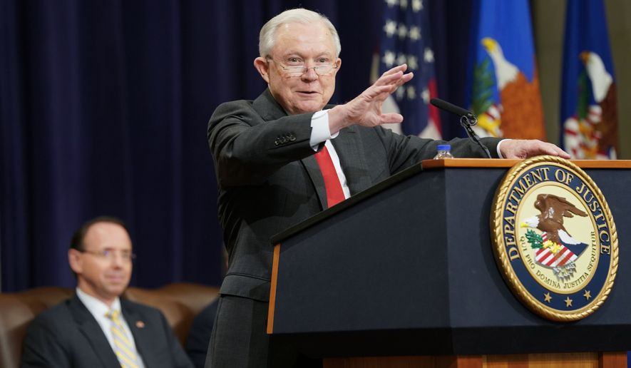 Attorney General Jeff Sessions gestures while speaking at the U.S. Marshals Service 37th Director's Honorary Awards Ceremony, at the Department of Justice in Washington, Thursday, Nov. 1, 2018. Sitting behind Sessions is Deputy Attorney General Rod Rosenstein. (AP Photo/Pablo Martinez Monsivais)