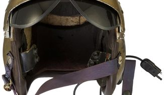 This undated photo provided by Heritage Auctions shows a helmet worn by John Glenn during the history-making flight, dubbed Project Bullet, in which the future astronaut set the transcontinental speed record in 1957.  Artifacts owned by the late Neil Armstrong will be offered for sale by Dallas-based Heritage Auctions starting Thursday, Nov. 1, 2018,  including pieces of a wing and propeller from the 1903 Wright Flyer the astronaut took with him to the moon in 1969.   (Courtesy of Heritage Auctions via AP)