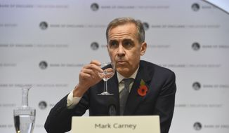 Bank of England Governor Mark Carney attends the Bank of England's inflation report press conference in the City of London, Thursday, Nov. 1, 2018. (Kirsty O'Connor/Pool via AP)