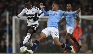 Fulham's Jean Michael Seri and Manchester City's Gabriel Jesus, right, during their English League Cup, Fourth Round match at the Etihad Stadium in Manchester, England, Thursday Nov. 1, 2018. (Mike Egerton/PA via AP)