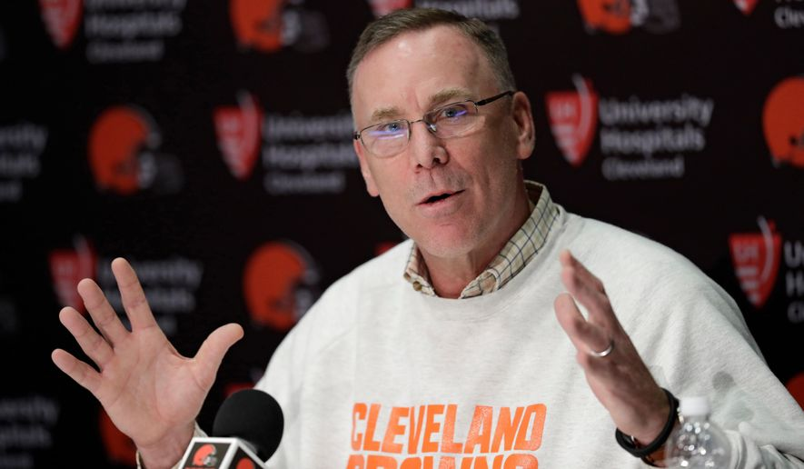 FILE - In this April 19, 2018, file photo, Cleveland Browns general manager John Dorsey answers questions about the draft during a news conference at the NFL football team's training camp facility, in Berea, Ohio. Dorsey, was previously in Kansas City before taking over in Cleveland late last year. (AP Photo/Tony Dejak, File)