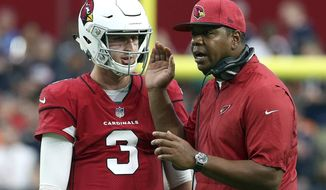 FILE - In this Sept. 23, 2018, file photo, Arizona Cardinals quarterback Josh Rosen (3) talks with quarterbacks coach Byron Leftwich during the second half of an NFL football game against the Chicago Bears in Glendale, Ariz. Leftwich was recently promoted to offensive coordinator, the fifth coordinator that Rosen has had in the past five seasons. (AP Photo/Ralph Freso, File)