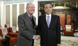 China's Premier Li Keqiang, right, shakes hands with U.S. Tennessee Senator Lamar Alexander during a meeting with a group of U.S. Republican senators and Congress members at Zhongnanhai leadership compound in Beijing, Thursday, Nov. 1, 2018. (Jason Lee/Pool Photo via AP)