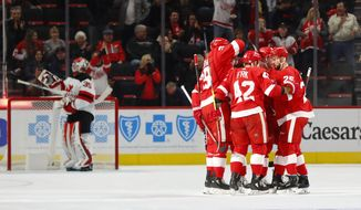 Detroit Red Wings right wing Martin Frk (42) celebrates his goal against the New Jersey Devils during the first period of an NHL hockey game Thursday, Nov. 1, 2018, in Detroit. (AP Photo/Paul Sancya)