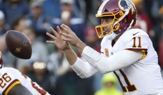 FILE - In this Sunday, Oct. 21, 2018, file photo, Washington Redskins quarterback Alex Smith (11) catches the snap during the first half of an NFL football game against the Dallas Cowboys in Landover, Md. Smith and the Redskins have averaged 212.7 yards in the air, and only three teams have fewer passing touchdowns than their eight.  (AP Photo/Andrew Harnik) ** FILE **