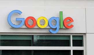 A sign on a building at the Google campus in Kirkland, Wash. is shown Thursday, Nov. 1, 2018. Google employees in Kirkland and around the world briefly walked off the job Thursday in a protest against what they said is the tech company's mishandling of sexual misconduct allegations against executives. (AP Photo/Ted S. Warren)