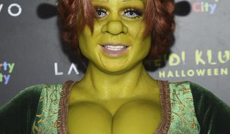 Model and television personality Heidi Klum dressed as the character Princess Fiona arrives at her 19th annual Halloween party at Lavo New York on Wednesday, Oct. 31, 2018, in New York. (Photo by Evan Agostini/Invision/AP)