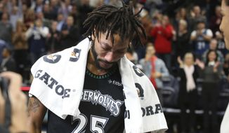 Minnesota Timberwolves' Derrick Rose composes himself before a television interview after he scored 50 points, a career high, against the Utah Jazz in an NBA basketball game Wednesday, Oct. 31, 2018, in Minneapolis. The Timberwolves won 128-125. (AP Photo/Jim Mone)