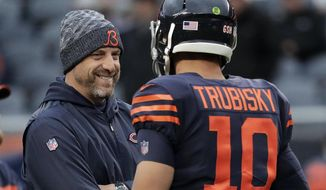 FILE -  In this Sunday, Oct. 28, 2018, file photo, Chicago Bears head coach Matt Nagy talks to quarterback Mitchell Trubisky (10) before an NFL football game against the New York Jets in Chicago. The Bears face the Buffalo Bills on Sunday. (AP Photo/Nam Y. Huh, File)