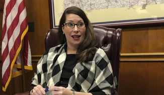 Kentucky Secretary of State Alison Lundergan Grimes speaks with reporters in her office at the state Capitol on Thursday, Nov. 1, 2018, in Frankfort, Ky. (AP Photo/Adam Beam) ** FILE **