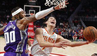 Atlanta Hawks guard Jeremy Lin (7) scores against Sacramento Kings center Willie Cauley-Stein (00) during the first half of an NBA basketball game Thursday, Nov. 1, 2018, in Atlanta. (AP Photo/John Bazemore)