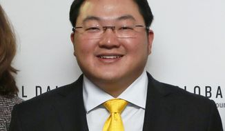 """FILE - In this April 23, 2015 file photo, Jho Low, Director of the Jynwel Foundation, poses at the launch of the Global Daily website in Washington, D.C. The Justice Department on Thursday, Nov. 1, 2018,  charged the fugitive Malaysian financier in a money laundering and bribery scheme that pilfered billions of dollars from a Malaysian investment fund created to promote economic development projects in that country. The three-count indictment charges Low Taek Jho, who is also known as Jho Low, with misappropriating money from the state-owned fund and using it for bribes and kickbacks to foreign officials, to pay for luxury real estate, art and jewelry in the United States and to fund Hollywood movies, including """"The Wolf of Wall Street."""" (Photo by Stuart Ramson/Invision for the United Nations Foundation/AP Images)"""