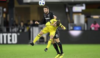 D.C. United defender Steve Birnbaum (15) batted for the ball against Columbus Crew SC midfielder Pedro Santos (7) during the first half of an MLS playoff soccer match, Thursday, Nov. 1, 2018, in Washington. (AP Photo/Nick Wass) ** FILE **