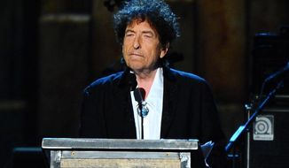 """FILE - In this Feb. 6, 2015 file photo, Bob Dylan accepts the 2015 MusiCares Person of the Year award at the 2015 MusiCares Person of the Year show in Los Angeles. The latest volume of Dylan's bootleg series, a six-disc box set being released Friday presents everything Dylan recorded for his milestone 1975 album """"Blood on the Tracks."""" (Photo by Vince Bucci/Invision/AP, File)"""