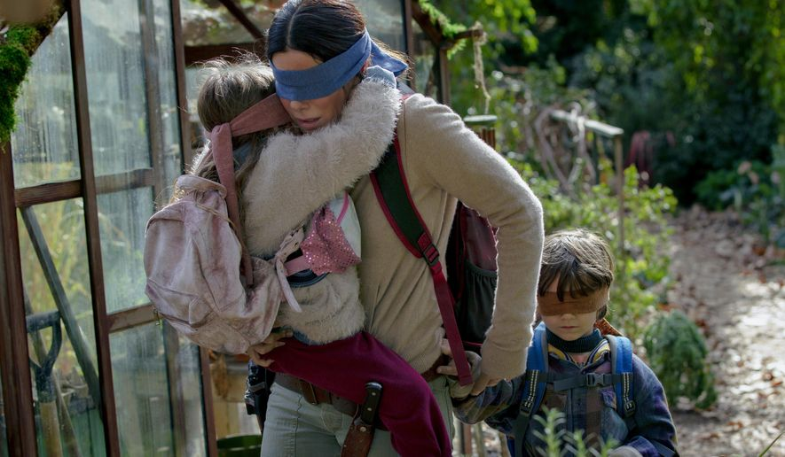 "This image released by Netflix shows Sandra Bullock in a scene from ""Bird Box,"" a film which will have an exclusive run in theaters before becoming available on Netflix's streaming service. (Saeed Adyani/Netflix via AP)"