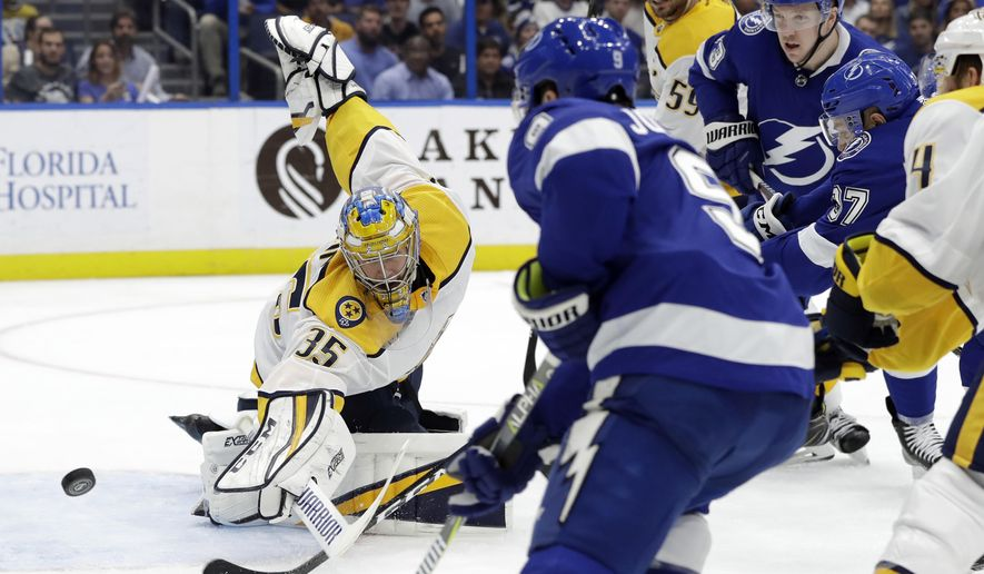 Nashville Predators goaltender Pekka Rinne (35) makes a save on a shot by Tampa Bay Lightning center Tyler Johnson (9) during the second period of an NHL hockey game Thursday, Nov. 1, 2018, in Tampa, Fla. (AP Photo/Chris O'Meara)