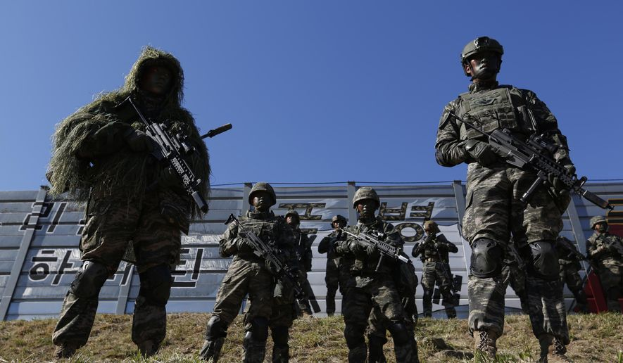 South Korean marines stand in attention during their regular drill on Yeonpyeong Island, South Korea Thursday, Nov. 1, 2018.  The U.S. and South Korea are reviewing whether they will conduct large-scale military exercises next year and will decide before December. South Korean Defense Minister Jeong Kyeong-doo told reporters Wednesday at the Pentagon that if more exercises are suspended the two countries will conduct other training to mitigate the lapse. He says the review will be done by Nov. 15. (Jeon Heon-kyun/Pool Photo via AP) **FILE**