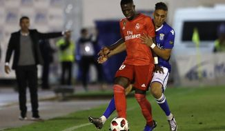 Real Madrid's Vinicius Junior, left, duels for the ball during the Spanish Copa del Rey soccer match between Melilla and Real Madrid at the Municipal Alvarez Claro stadium in the Spain's enclave of Melilla, Wednesday, Oct. 31, 2018.(AP Photo/Javier Gandul)