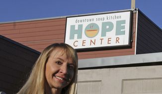Denise Harle, an attorney with the conservative Christian law firm Alliance Defending Freedom, poses for a photo outside the Hope Center women's shelter in downtown, Anchorage, Alaska, on Thursday, Nov. 1, 2018. Hope Center is suing the city of Anchorage to block it from requiring the faith-based shelter to accept transgender women. (AP Photo/Mark Thiessen)